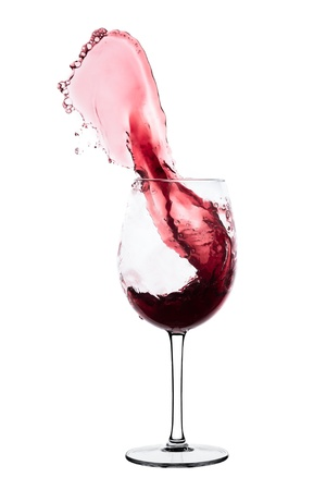 18360251 - red wine splashing out of a glass, isolated on white